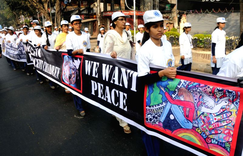 People participate in a silent rally to condemn the recent attack on a Peshawar school that left 148 dead, mostly children in Kolkata on Dec 21, 2014.
