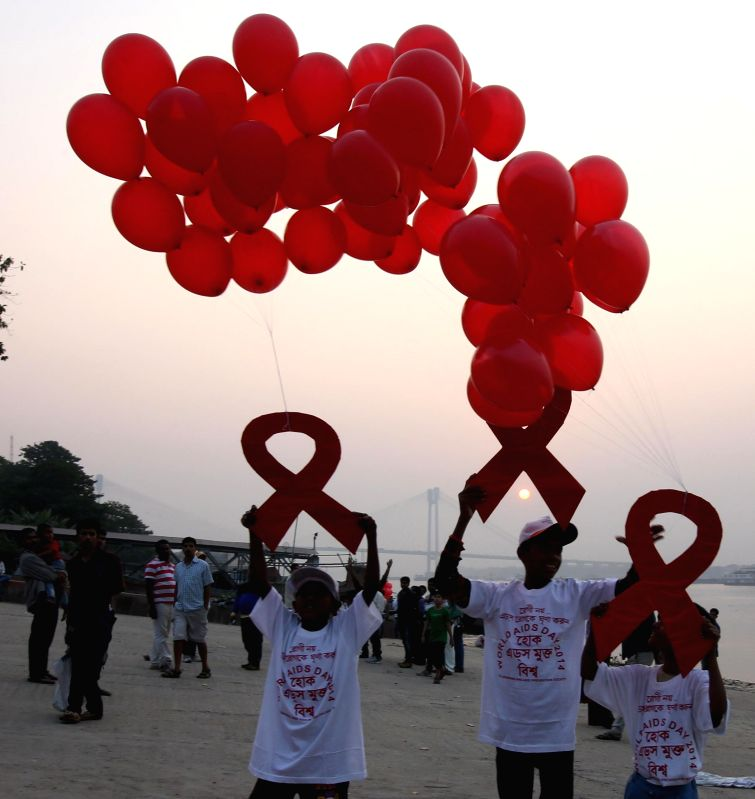 People participate in an AIDS Awareness Campaign on World AIDS Day in Kolkata on Dec 1, 2014.