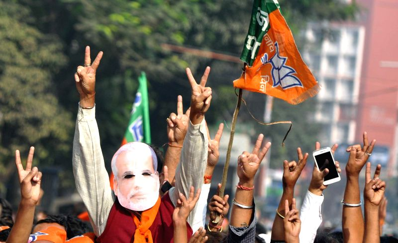 People participate in BJP chief Amit Shah's rally in Kolkata, on Nov 30, 2014.