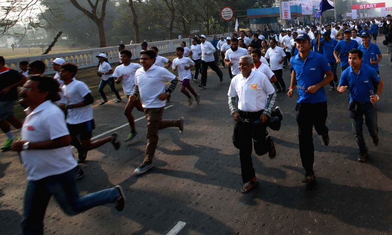 People participate in Kolkata Marathon 2015 at Red Road in Kolkata, on Feb 8, 2015.
