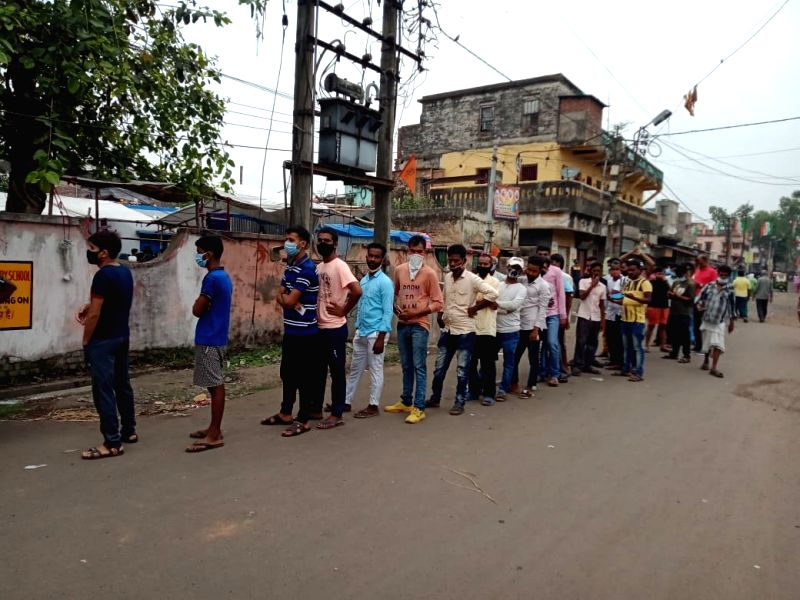 Kolkata: People waiting for casting their votes at Bhatpara constituency in North 24 Pargana in West Bengal On Thursday, 22 april, 2021.(photo:IANS)