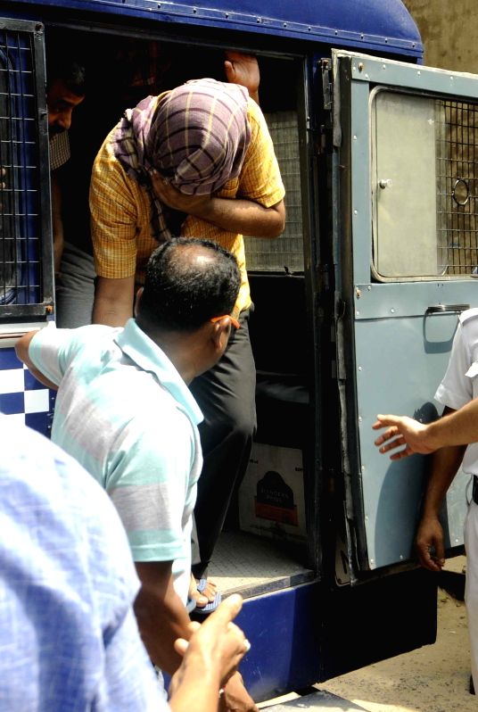 People who shot at a policeman being taken to be produced before a Kolkata court on May 2, 2015.