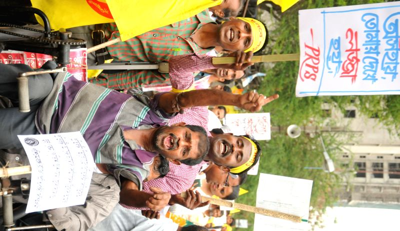 Physically disabled people participate in a rally against West Bengal government in Kolkata, on April 26, 2015.
