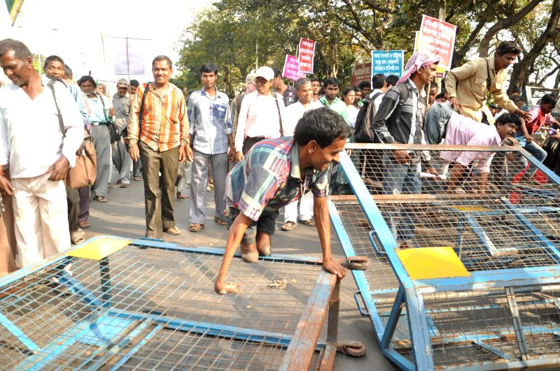 Physically handicapped people participate in a law violation programme to protest against West Bengal government in Kolkata, on March 2, 2015.
