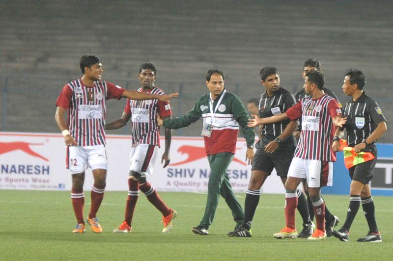 Players in action during a match between Mohun Bagan and Mumbai FC at Salt Lake Stadium in Kolkata, on Jan 18, 2015. Mohun Bagan won. Score: 3-1.