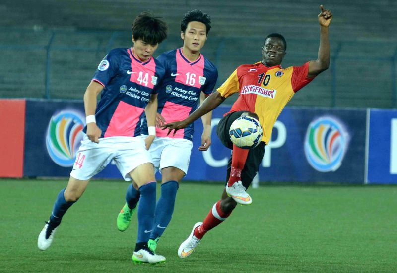 Players in action during​ an​ AFC Cup 2015 match between East Bengal F.C. (IND) and Kitchee Sports Club (HKG) at Salt Lake in Kolkata on March 10, 2015.