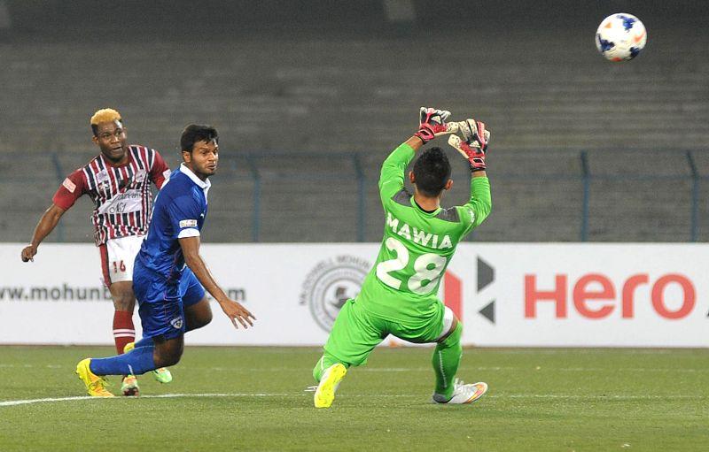 Players in action during an I-League match between Mohun Bagan and Bengaluru Football Club at Salt Lake Stadium in Kolkata, on Feb 20, 2015. Mohun Bagan won. Score: 4-1