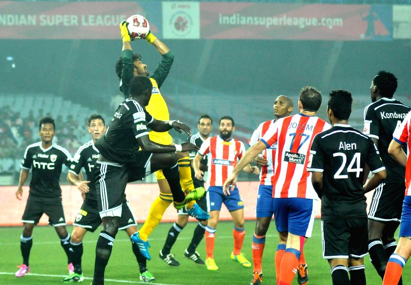Players in action during an ISL match between Atletico de Kolkata and NorthEast United FC in Kolkata, on Nov 18, 2014.