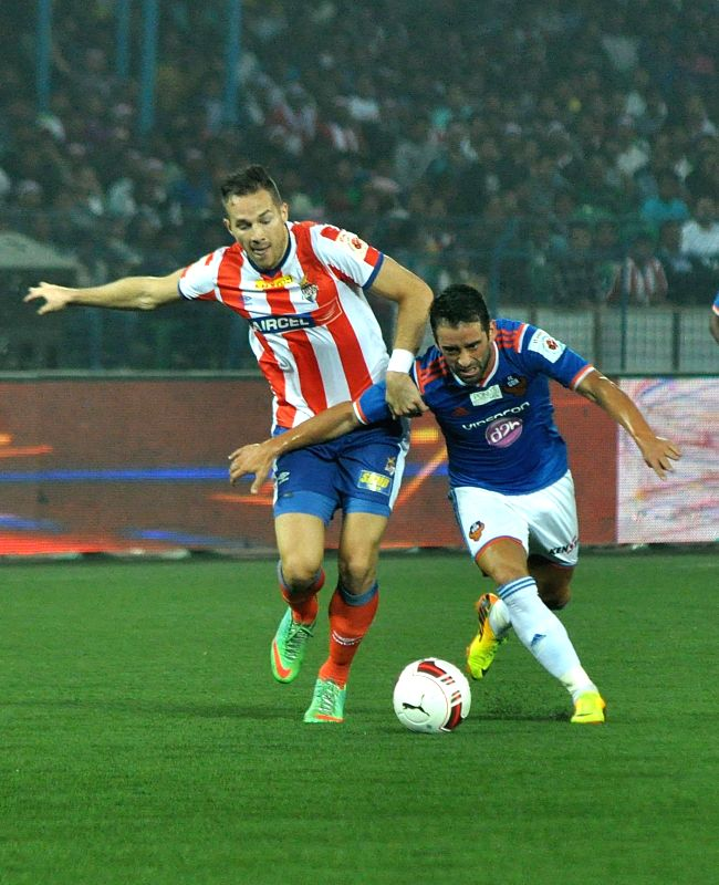 Players in action during an ISL match between Atletico de Kolkata and FC Goa in Kolkata on Dec 10, 2014.