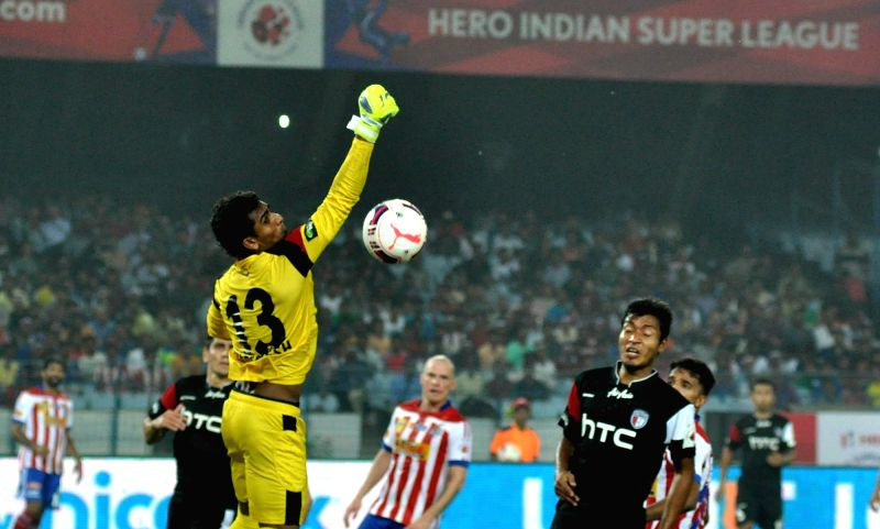 :Kolkata: Players in action during an ISL match between Atletico de Kolkata and NorthEast United FC in Kolkata on Nov. 7, 2015. .