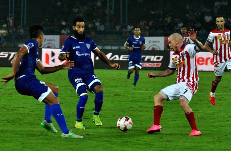 :Kolkata: Players in action during an ISL match between Chennaiyin FC and Atletico de Kolkata in Kolkata, on Nov 18, 2015. .