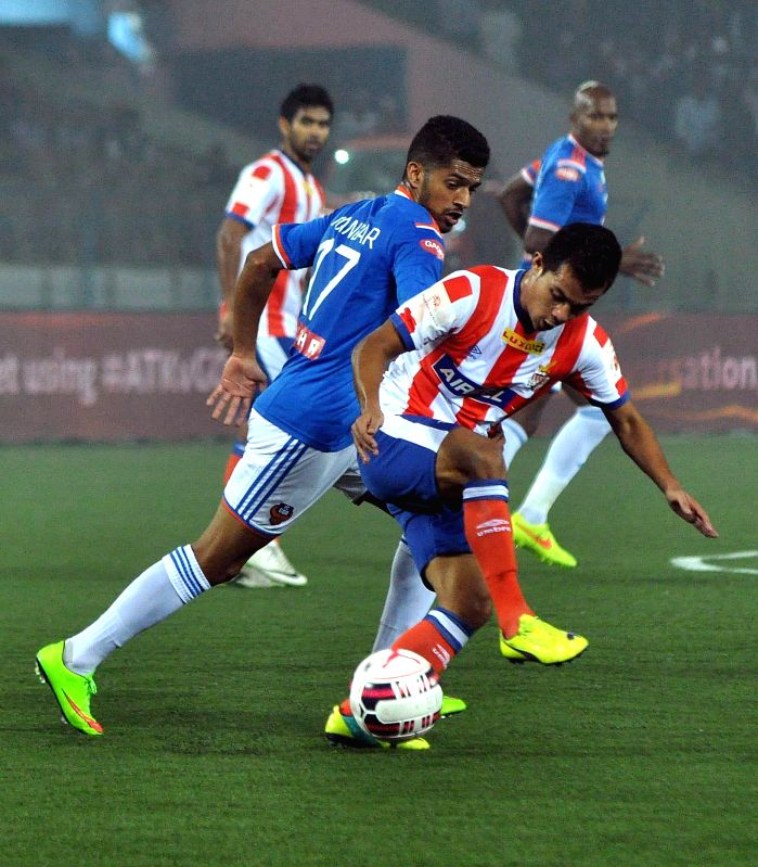 Players in action during an ISL semi-final match between Atletico de Kolkata and FC Goa in Kolkata, on Dec 14, 2014.