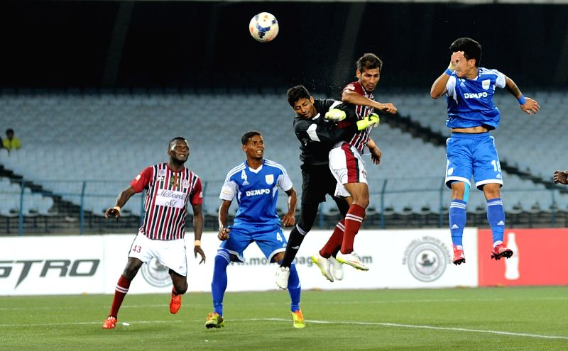 Players in action during I-League match between Mohun Bagan and Dempo SC (Blue) at Salt Lake Stadium in Kolkata on March 22, 2015. Mohun Bagan won the match 2-0.