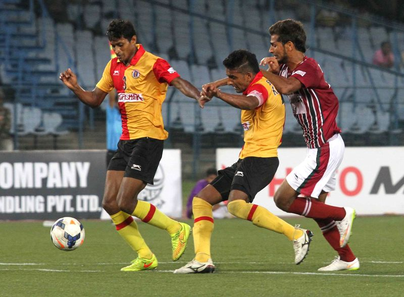 Players in action during I-League match between Mohun Bagan and East Bengal (Red and Yellow) at Salt Lake Stadium in Kolkata on March 28, 2015. Mohun Bagan won the match 1-0.
