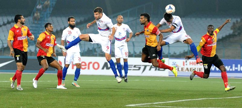 Players of East Bengal and Bharat FC in action during an I-league match in Kolkata, on Feb 15, 2015. Score: 1-1.