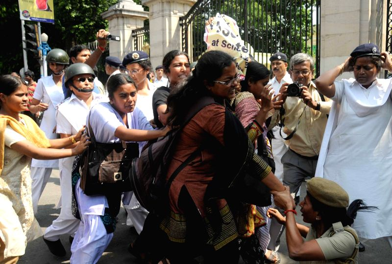 Police take away DSO activists demonstrating outside Raj Bhawan to press for re-introduction of pass-fail system in schools in Kolkata on April 9, 2015.
