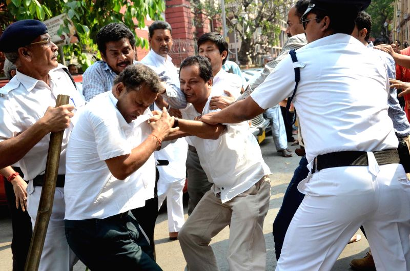 Policemen intervene as two groups of BJP workers clash with each other over distribution of tickets for upcoming Kolkata Municipal Corporation outside the party office in Kolkata, on March ...