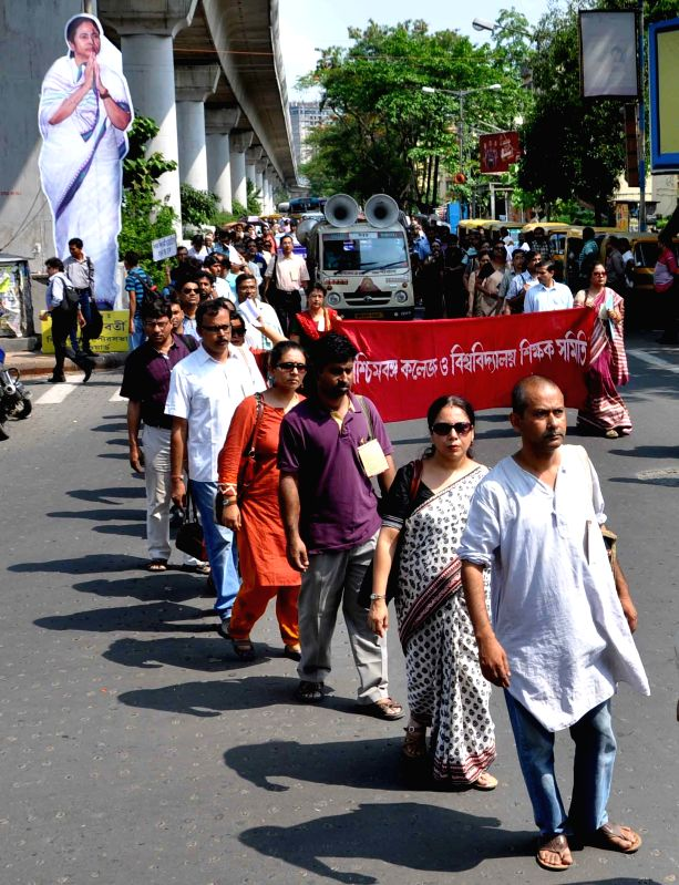 Professors stage a demonstration against West Bengal government in Kolkata, on April 27, 2015.