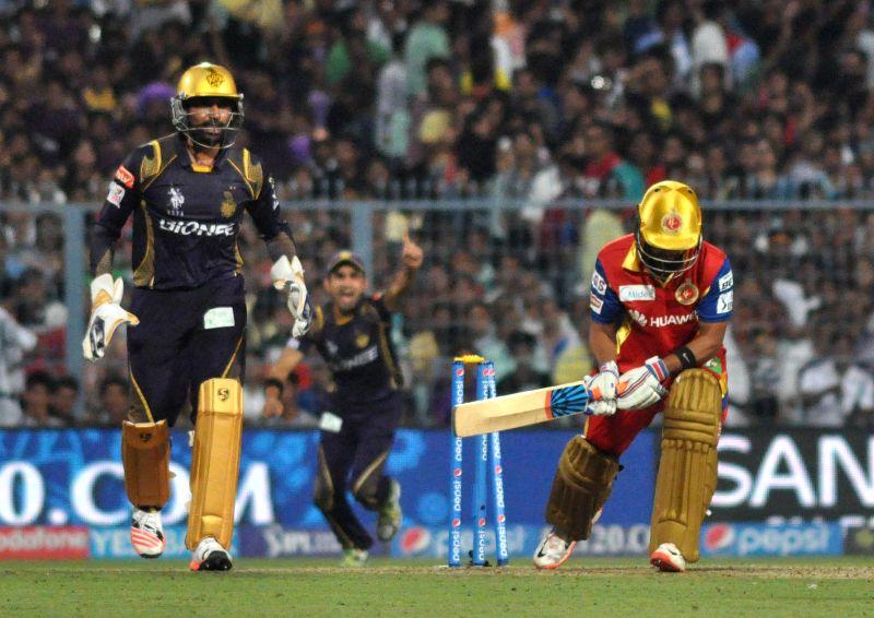 RCB batsman Mandeep Singh is bowled out during IPL match between Kolkata Knight Riders (KKR) and Royal Challengers Bangalore (RCB) at Eden Gardens in Kolkata on April 11, 2015. - Mandeep Singh