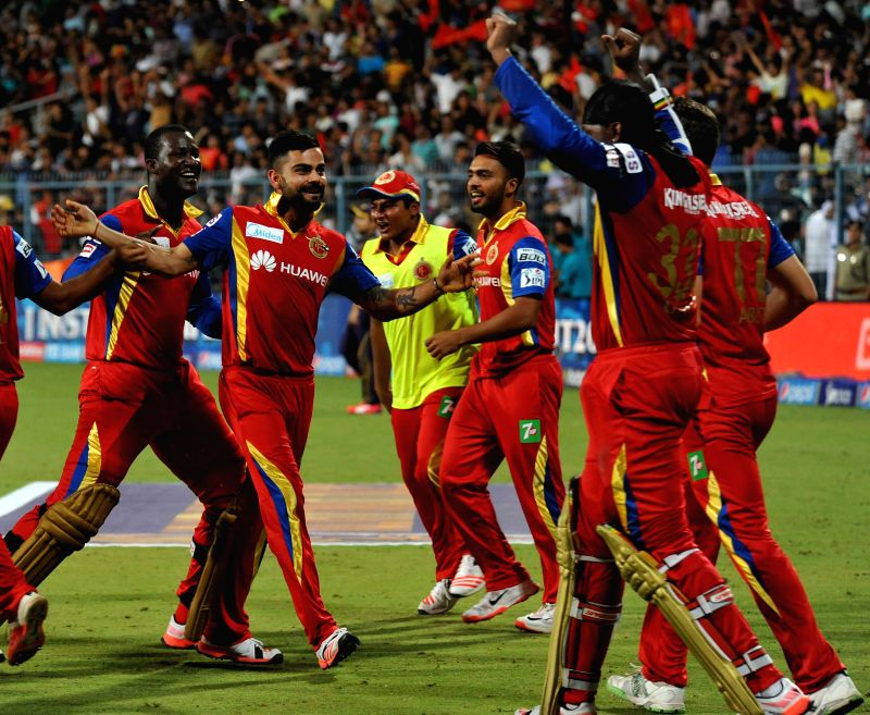 RCB players celebrate the win against KKR during the IPL match between Kolkata Knight Riders (KKR) and Royal Challengers Bangalore (RCB) at Eden Gardens in Kolkata on April 11, 2015.