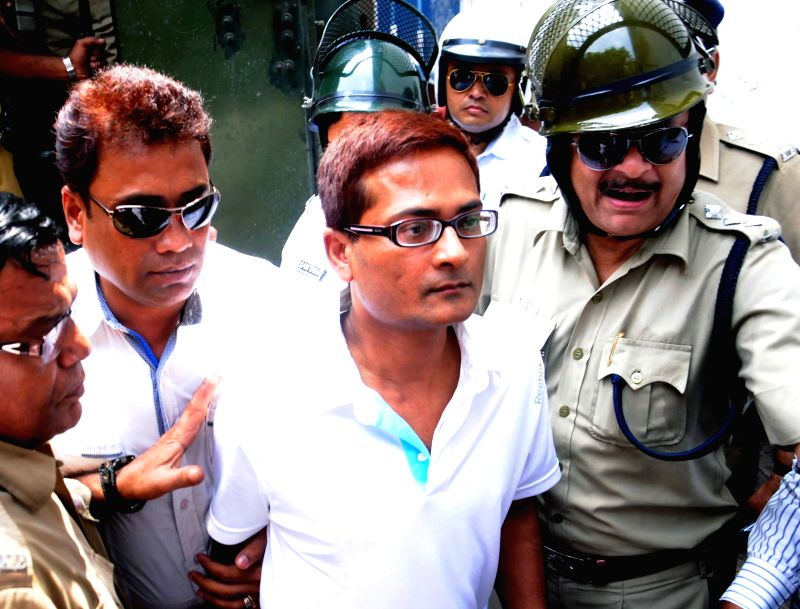Rose Valley chairman Gautam Kundu being taken to be produced in a Kolkata Court on March 31, 2015.