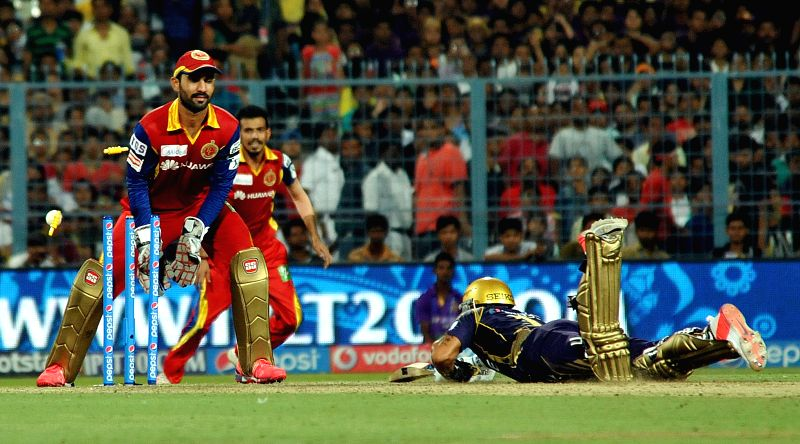 Royal Challengers Bangalore (RCB) wicketkeeper Dinesh Karthik in action during an IPL-2015 match between Kolkata Knight Riders (KKR) and Royal Challengers Bangalore (RCB) at Eden Gardens in ...