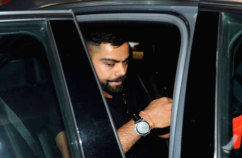 Royal Challengers Bangalore (RCB) captain Virat Kohli arrives at Netaji Subhas Chandra Bose Airport in Kolkata on April 6, 2015.