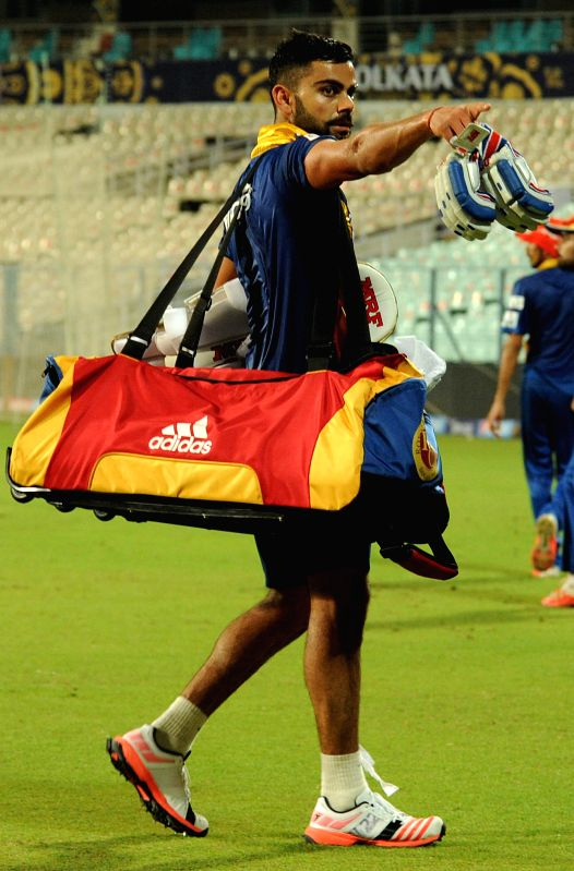 Royal Challengers Bangalore (RCB) captain Virat Kohli during a practice session at the Eden Gardens in Kolkata, on April 10, 2015. - Virat Kohli