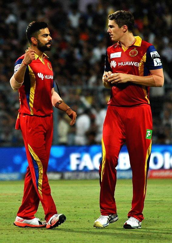 Royal Challengers Bangalore (RCB) captain Virat Kohli with teammate Sean Abbott in action during an IPL-2015 match between Kolkata Knight Riders (KKR) and Royal Challengers Bangalore (RCB) ... - Virat Kohli