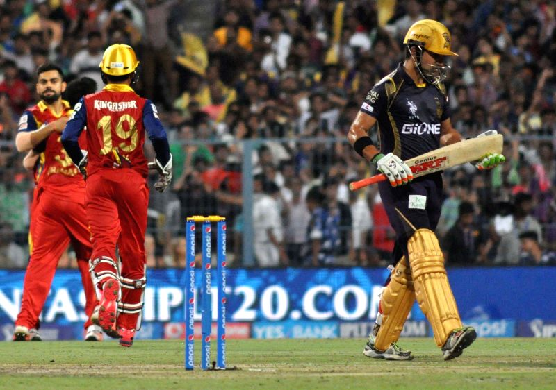 Royal Challengers Bangalore (RCB) celebrate fall of a wicket during an IPL-2015 match between Kolkata Knight Riders (KKR) and Royal Challengers Bangalore (RCB) at Eden Gardens in Kolkata on ...