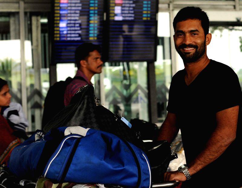 Royal Challengers Bangalore (RCB) player Dinesh Karthik arrives at Netaji Subhas Chandra Bose Airport in Kolkata on April 6, 2015.