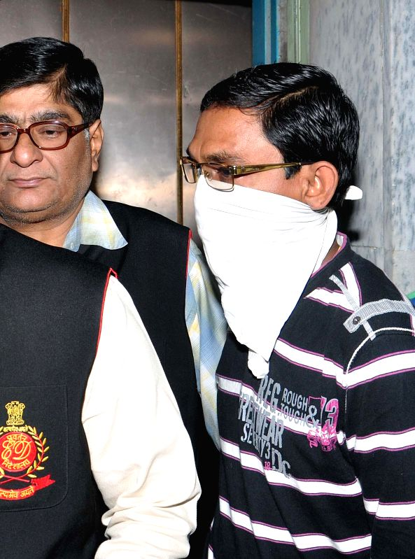 Saradha agent Prasanta Naskar being taken to be produced before a Kolkata court in connection with the multi-crore-rupee Saradha chit fund scam  on Feb 14, 2015.