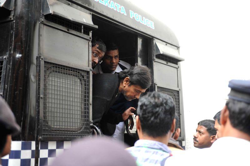 Saradha scam kingpin Sudipta Sen being taken to be produced before a Kolkata court on Dec 12, 2014.