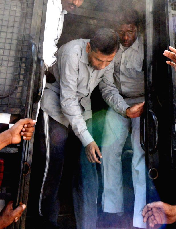 Saradha scam kingpin Sudipta Sen being taken to be produced before a Kolkata court on March 13, 2015.