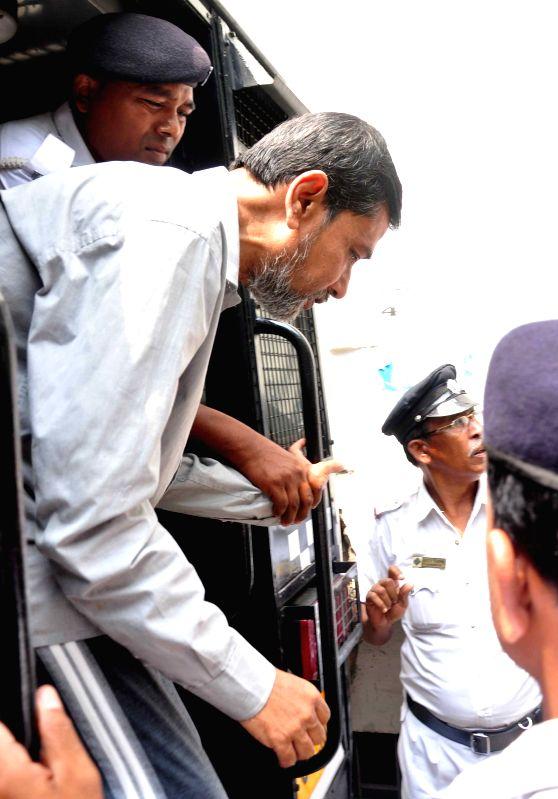Saradha scam kingpin Sudipta Sen being taken to be produced before a Kolkata court on April 6, 2015.