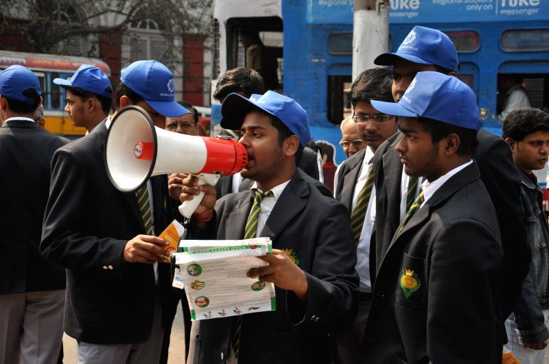 School students control traffic during Road Safety Week in Kolkata, on Feb 9, 2015.