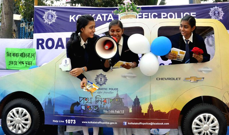 School students participate during a traffic awareness campaign to celebrate `Road Safety Week` in Kolkata, on Feb 10, 2015.