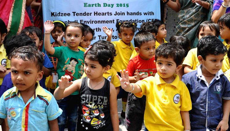 School students participate in a rally organised on `World Earth Day` in Kolkata, on April 22, 2015.