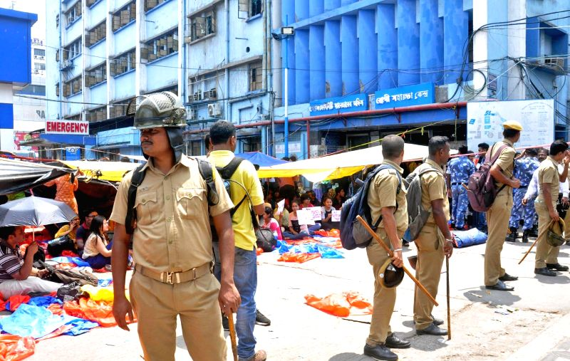 Kolkata: Security personnel deployed at NRS Medical College and Hospital where junior doctors went on a strike after one of their colleagues was allegedly attacked by the family of a patient who died, in Kolkata on June 11, 2019. (Photo: Kuntal Chakr