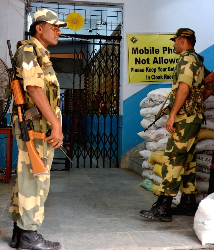 Kolkata: Security personnel stand guard outside a strong room where Electronic Voting Machines (EVM) have been stored after the last phase of 2019 Lok Sabha elections concluded on Sunday, in Kolkata on May 20, 2019. (Photo: Kuntal Chakrabarty/IANS)