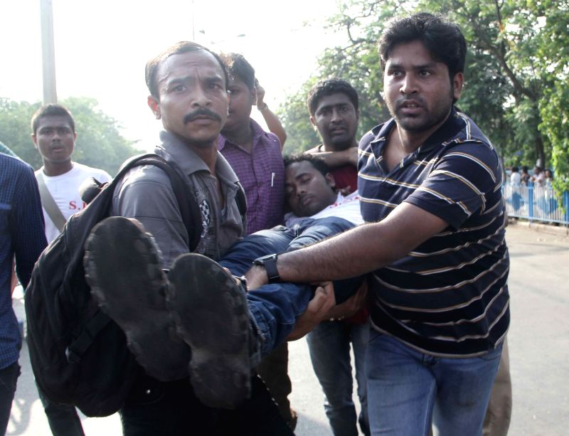 SFI activists injured in police lathi-charge being taken away in Kolkata, on April 2, 2015.