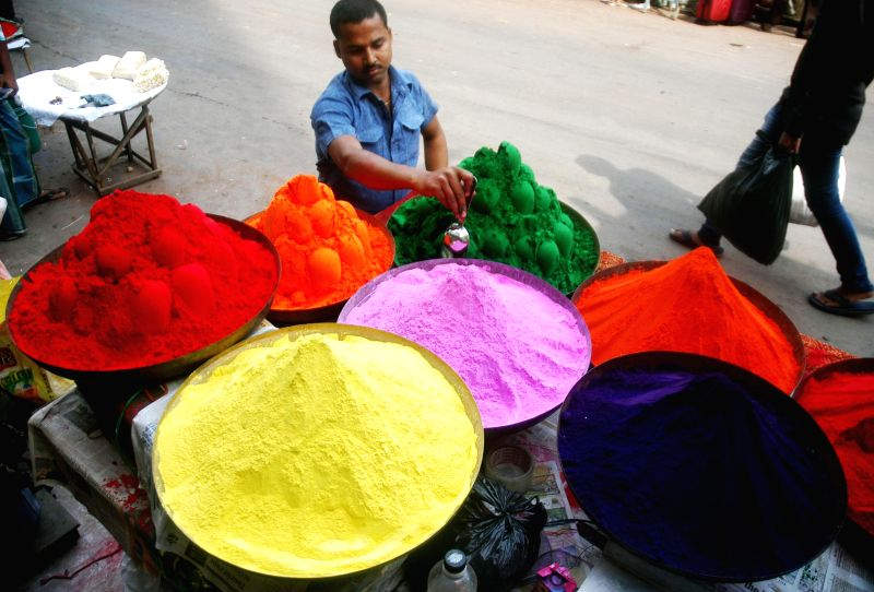 Small-time businessmen sell colours and allied products ahead of `Holi` in Kolkata, on March 2, 2015.