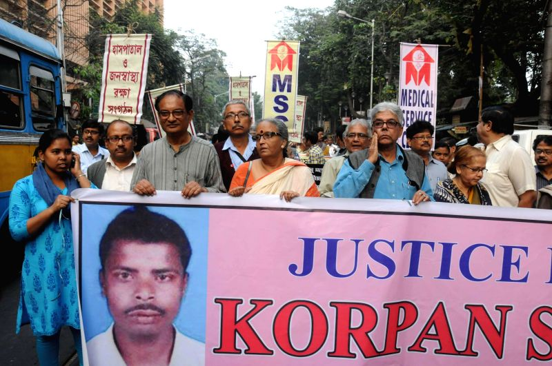 Social activist Dr. Binayak Sen and others take part in a rally to demand justice for Korpan Shah, a mentally challenged youth who was lynched at state-run NRS Medical College and Hospital, . - Korpan Shah