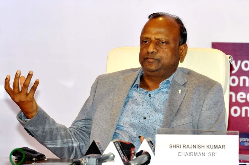 Kolkata: State Bank of India (SBI) chairman Rajnish Kumar addreses a press conference in Kolkata on Aug 18, 2019. (Photo: Kuntal Chakrabarty/IANS)