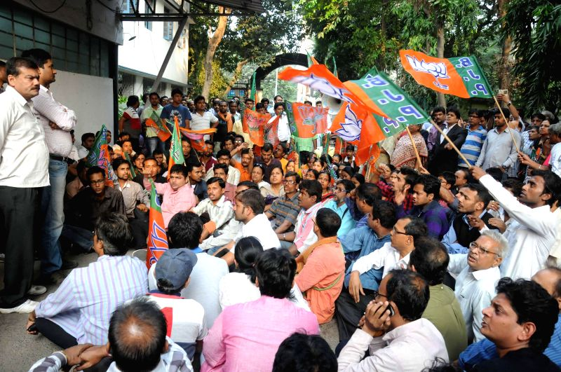 State BJP supporters agitate inside Alipur Police station against recent violence in the police station in Kolkata on Nov. 20, 2014.