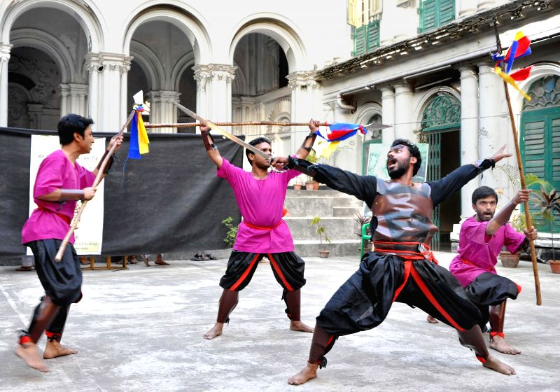 Students of Rabindra Bharati University enact `Bandi Bihanga` - a drama based on Rabindranath Tagore`s `Tota Kahini` at Jorasanko Thakurdalan in Kolkata, on Dec 26, 2014.