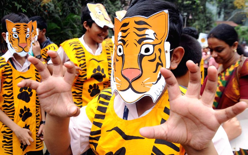 Students participate in a programme organised to observe `World Wildlife Day` in Kolkata, on March 3, 2015.