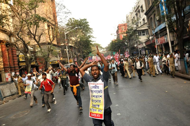 SUCI activists participant in a demonstrate rally against the West Bengal Government in Kolkata on Feb 5, 2015.