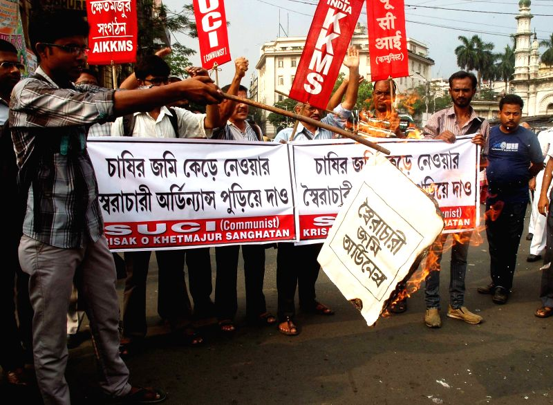 SUCI activists stage a demonstration against land acquisition law in Kolkata on April 6, 2015.