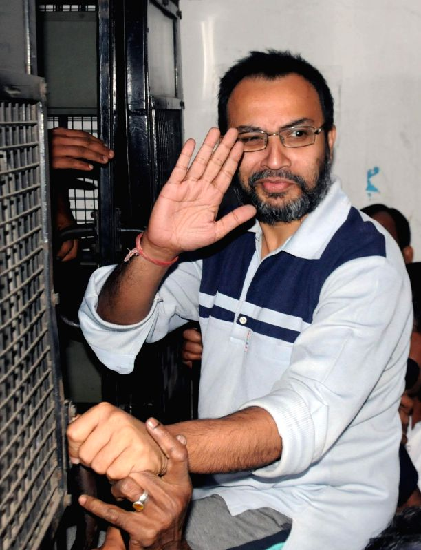 Suspended Trinamool Congress MP Kunal Ghosh being taken to be produced at a Kolkata Court in connection with multi-crore-rupee Saradha chit fund scam in Kolkata, on Nov 21, 2014.